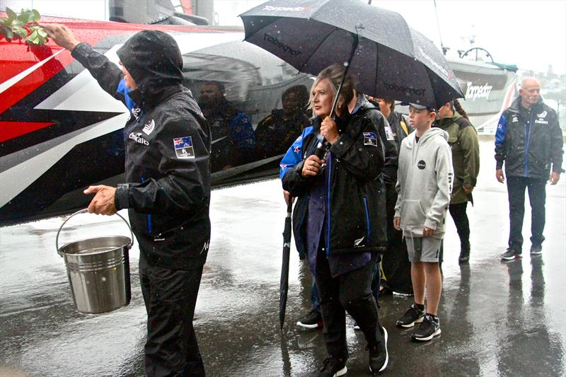 Tina Symmans holds the umbrella as Sir Stephen Tindall performs the traditional blessing of Emirates Team NZ's new AC50 and eventual Americas Cup winner. Heavy rain is always a good omen photo copyright Richard Gladwell taken at  and featuring the AC50 class