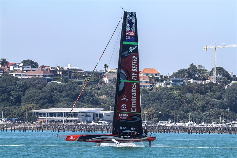 Emirates Team New Zealand's Te Aihe,  is towed past the new Hyundai Marine Sports Centre which houses the Royal Akarana Yacht Club. Waitemata Harbour, November 7, 2019 photo copyright Richard Gladwell, Sail-World.com / nz taken at Royal New Zealand Yacht Squadron and featuring the AC75 class
