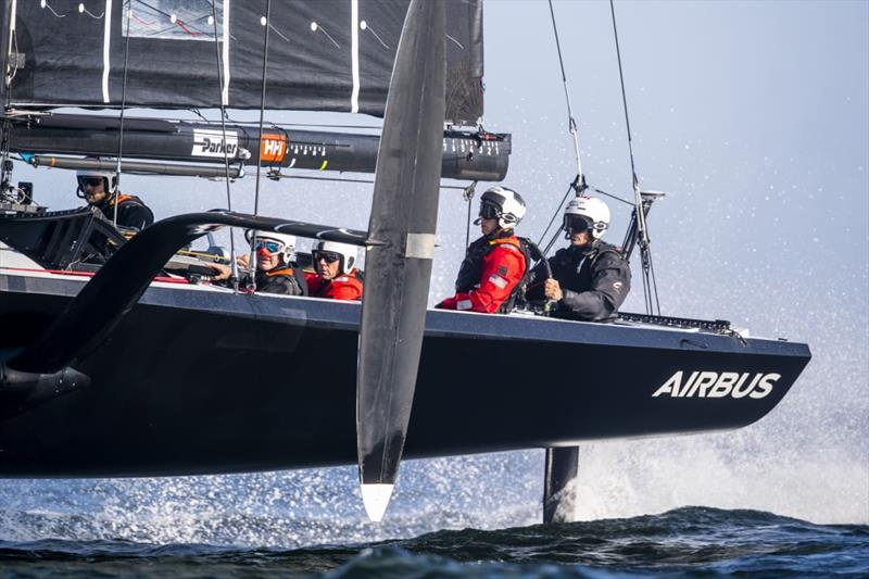 Sean Clarkson (third from right) on board American Magic's 38ft training boat, The Mule, with Dean Barker at the wheel (right).  - photo © Amory Ross