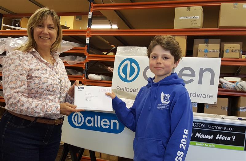 Allen Brothers MD, Liz Adams hands over the official measurement papers for the Allen Academy Optimist to 11 year old Nick Evans from Colchester - photo © Jeremy Nicholson