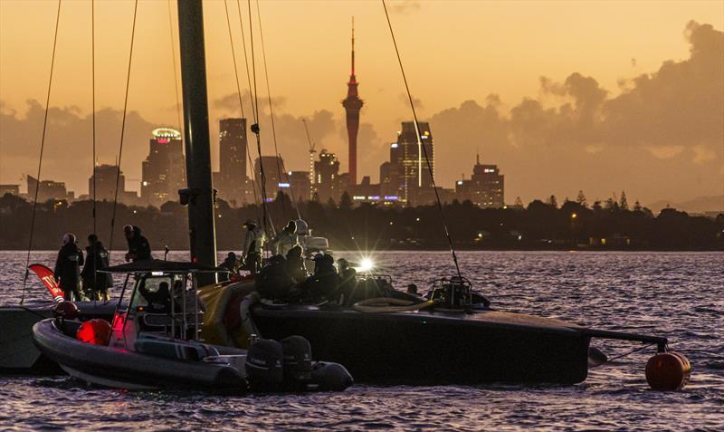 American Magic's Patriot under tow at sunset on the Waitemata harbour - January 17, 2021, Prada Cup - photo © COR 36 | Studio Borlenghi