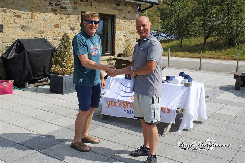 Ian Smith, Blaze Northern Champion, receiving congratulations from Race Officer Terry Pressdee photo copyright Paul Hargreaves taken at Yorkshire Dales Sailing Club and featuring the Blaze class