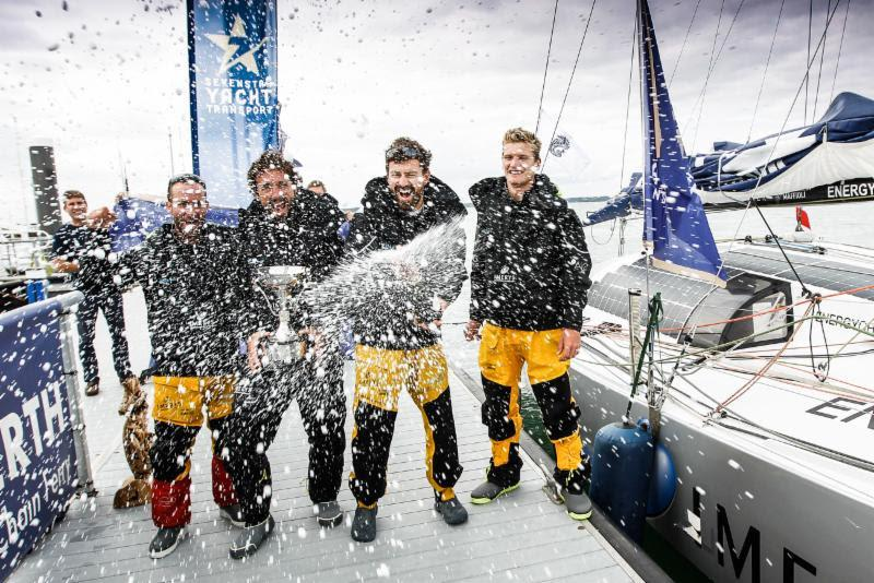 Champagne celebration for Imerys Clean Energy's Phil Sharp, Julien Pulvé, Pablo Santurdé and Sam Matson after completing the race in record time for a 40ft yacht photo copyright Paul Wyeth / RORC taken at Royal Ocean Racing Club and featuring the Class 40 class