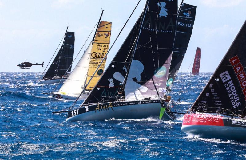 The ten-strong Class40 fleet with the media helicopter capturing their start - RORC Caribbean 600 - photo © RORC / Arthur Daniel