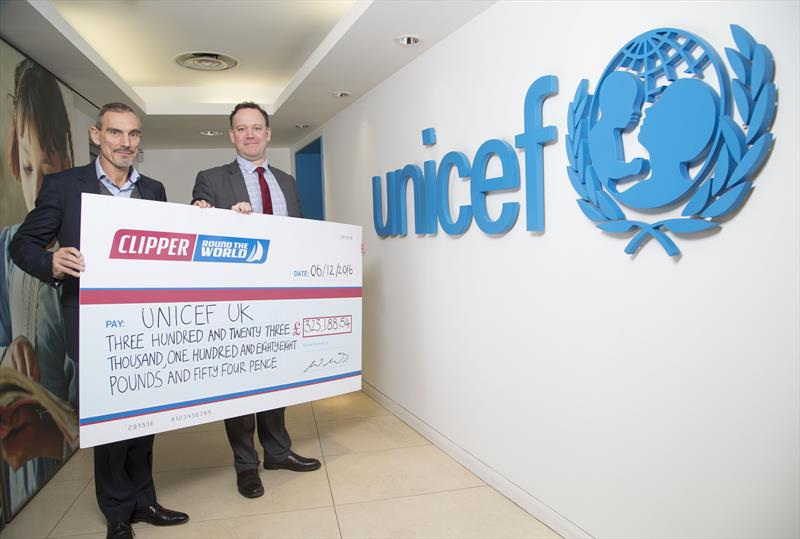 William Ward presending a cheque for £323,188.54 to Unicef UK - photo © Clipper Ventures