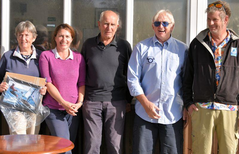 Keith Paul retires from competitive sailing (on the left, his wife and daughter, and on the right, Dougal Henshall and Chris Boshier from the BCA) photo copyright Lin Henshall taken at Weston Sailing Club and featuring the Contender class