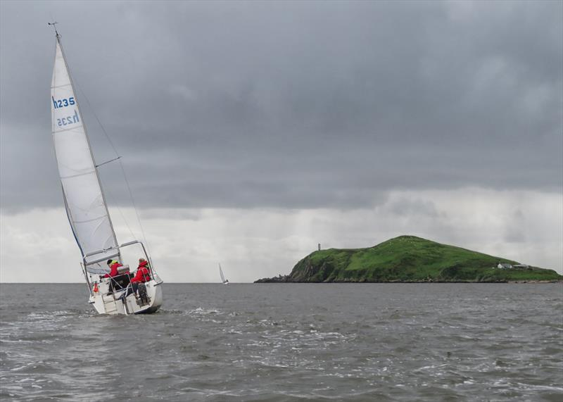 Heading for Hestan; 'Osprey II' helmed by Paul Gray with crew Gavin Phillips, 'Kintra' already along way ahead during the Catherinefield Windows RNLI Regatta in Kippford - photo © John Sproat