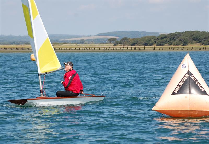 Ian Proctor's son Roger was a core part of the weekend and is seen here sailing the OD11, the boat that would eventually become the Topper (note the shape of the bow transom) at the Bosham Classic Boat Revival 2018 - photo © Dougal Henshall