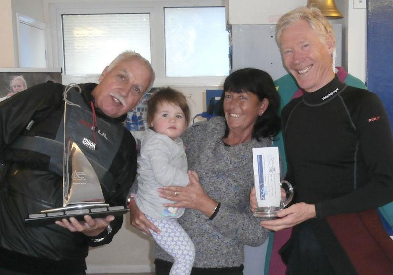 Howard Freer receives Roger's Race Trophy from Phil Bailey, club Commodore, and representatives of Roger's family - photo © Chris Jones