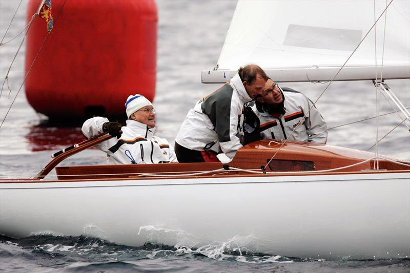 HRH Prince Henrik at the helm of one of his six Dragons - photo © RDYC