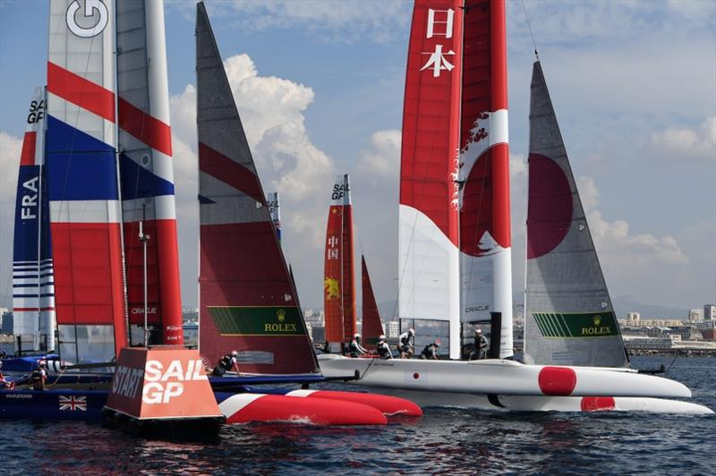 Close sailing between Great Britain SailGP Team helmed by Dylan Fletcher and Japan SailGP Team skippered by Nathan Outteridge as they compete in a practice race ahead of the final SailGP event of Season 1 in Marseille, France. - photo © Ricardo Pinto for SailGP