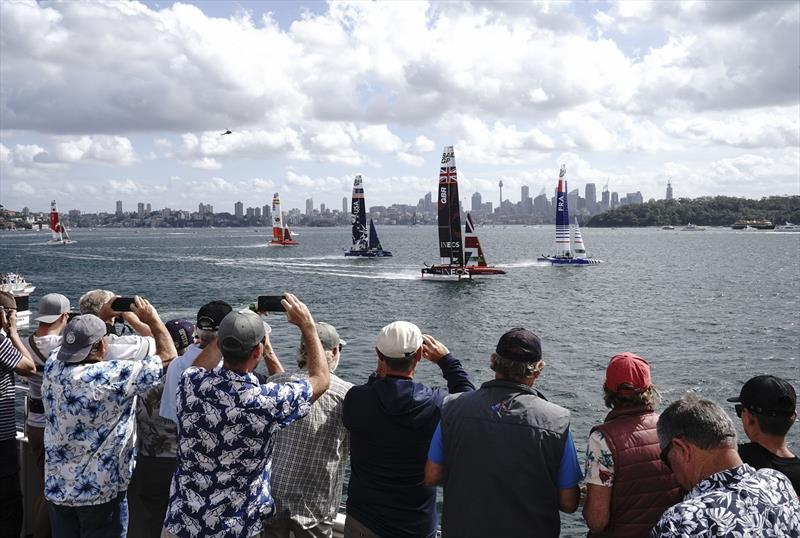 Spectators watch the action from a spectator boat as Great Britain SailGP Team helmed by Ben Ainslie lead the fleet in the first race on Race Day 1 - Sydney SailGP - photo © Thomas Lovelock for SailGP