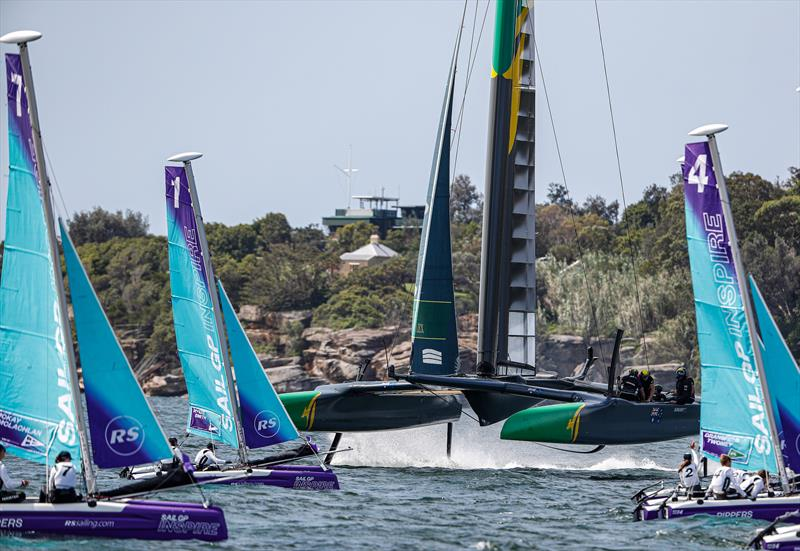 Australia SailGP Team helmed by Tom Slingsby sails close to young sailors in the SailGP Inspire program as they warm up before racing on Race Day 1.- SailGP - Sydney - Season 2 - February 2020 - Sydney, Australia. - photo © Craig Greenhill/SailGP