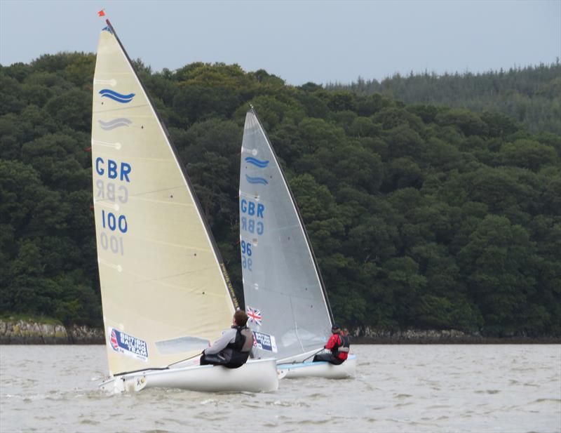 Two Finn class dinghies in close company; Mark Crowther leads Stewart Mitchell during the Catherinefield Windows RNLI Regatta in Kippford - photo © John Sproat