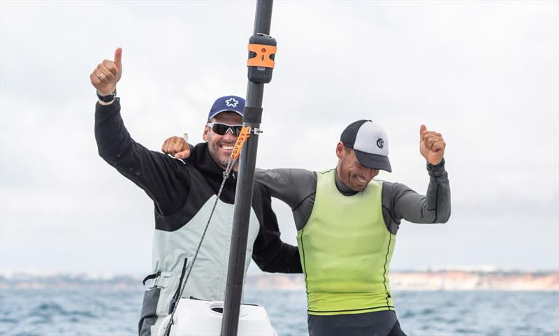 Berecz celebrates with coach Mateusz Kusznierewicz - 2021 Open and U23 Finn European Championship photo copyright Joao Costa Ferreira taken at  and featuring the Finn class
