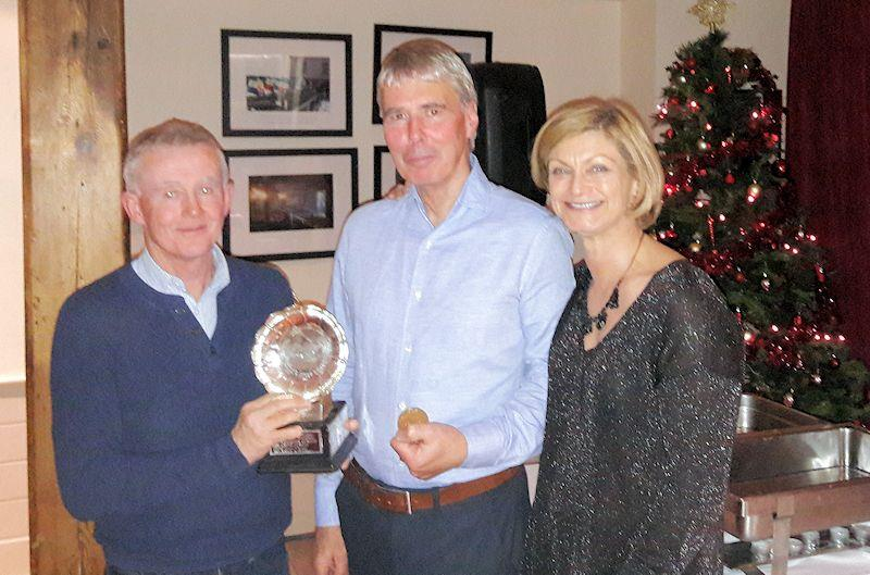 Class Treasurer, Marie Barry presents the winners of the Travellers' Trophy, Niall McGrotty & Neil Cramer with the trophy and the Gold Medals at the Irish Fireball Class Prize Giving photo copyright Cormac Bradley taken at National Yacht Club and featuring the Fireball class