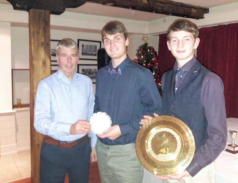 Daniel (L) and Harry Thompson collect the Travellers' Trophy for the Silver fleet (Daniel) and the India Trophy (Harry) from Class Chairman Neil Cramer at the Irish Fireball Class Prize Giving photo copyright Cormac Bradley taken at National Yacht Club and featuring the Fireball class