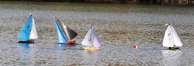 A gust has upset 35 which has rounded the windward mark with the others approaching it - Fred's Big Toephy (Footy class at Chertsey) photo copyright Peter Dunne taken at Guildford Model Yacht Club and featuring the Footy class