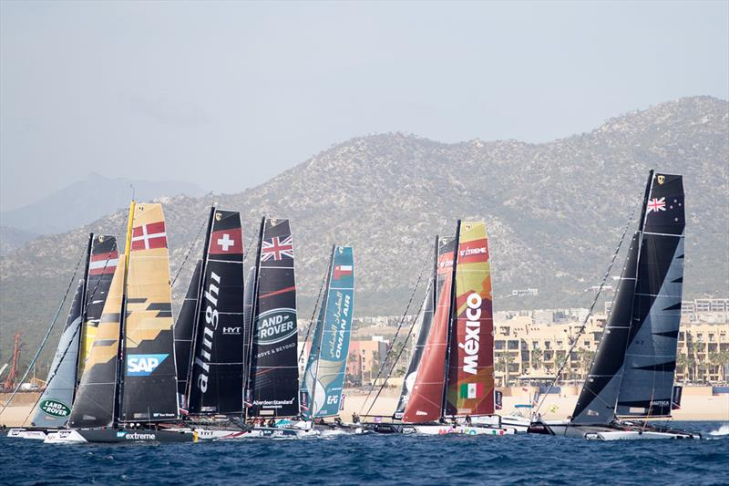 The eight-strong fleet of GC32 catamarans line up for a start during a race on the opening day in Los Cabos. - photo © Lloyd Images