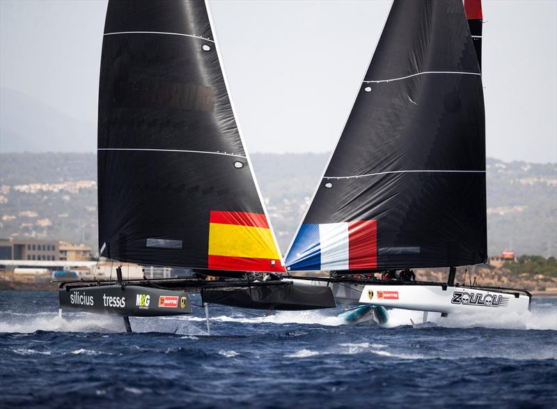The Iker Martinez-steered M&G Tressis Silicius crosses ahead of Erik Maris' Zoulou. - 38 Copa del Rey MAPFRE - photo © Sailing Energy / GC32 Racing Tour