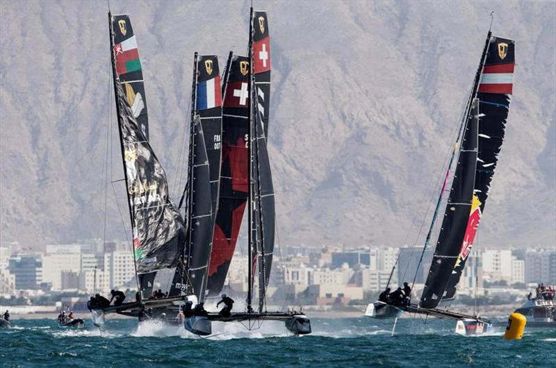 Alinghi leads at the all-important first reaching mark - GC32 Oman Cup day 3 photo copyright Sailing Energy / GC32 Racing Tour taken at  and featuring the GC32 class