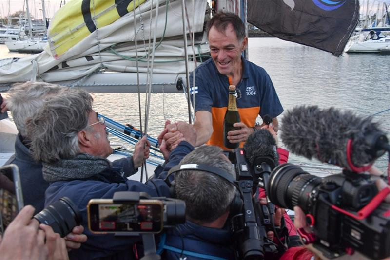 Media scrum: Lehtinen besieged by media and fellow Golden Globe race skippers wanting a word and to welcome him back - photo © Christophe Favreau / PPL / GGR