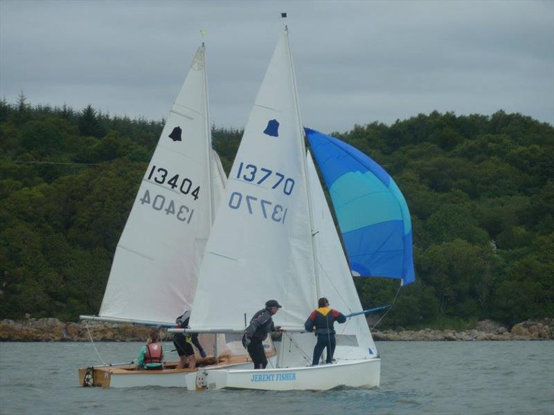 GP14 'Jeremy Fisher' crew Beatrice Overend sets the spinnaker,  just ahead of Shona and Alasdair MacDonald during Solway YC Kippford Week - photo © Anne-Marie Williams