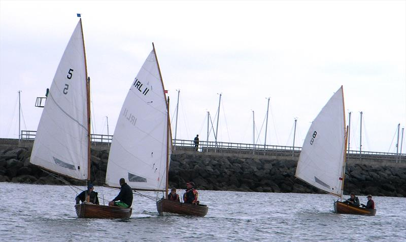 Dorado (No.5) steered by Mark Delany, Pixie (No.11) steered by George Miller and Cora (No.8) Steered by Margaret Delany during the International 12 foot Irish championship of 2016 in Dun Laoghaire Harbour - photo © Vincent Delany