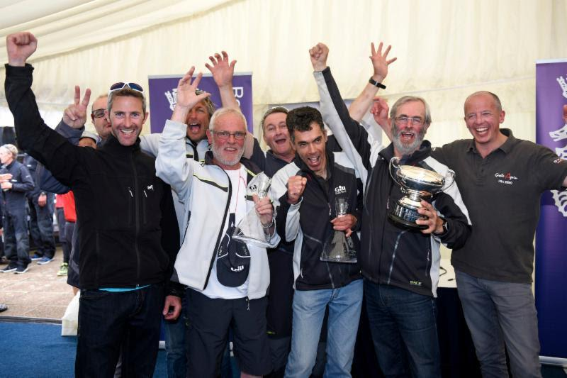 Clutching prizes for securing first place overall in IRC Three and the RORC IRC National Championship trophy (joint winner with Yes!), the crew of Dunkerque - Les Dunes de Flandre - photo © Rick Tomlinson / www.rick-tomlinson.com