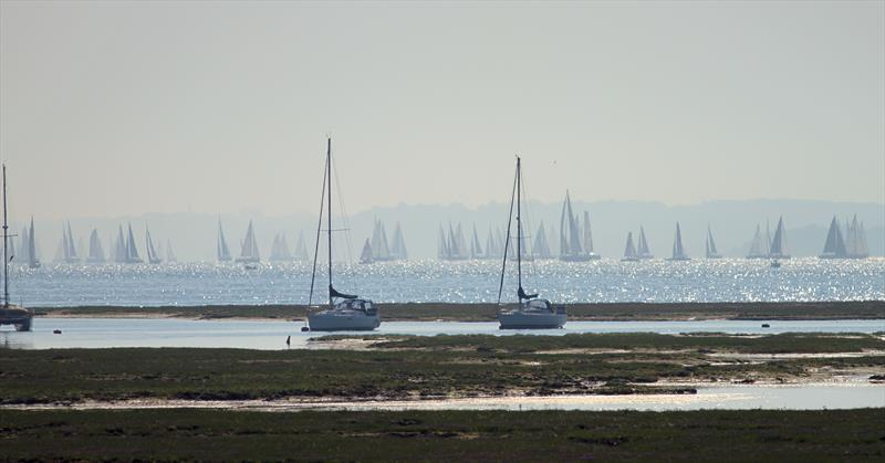 The leaders pass Hurst Castle and approach the Needles during the 2018 Round the Island Race photo copyright Mark Jardine / YachtsandYachting.com taken at Island Sailing Club and featuring the IRC class