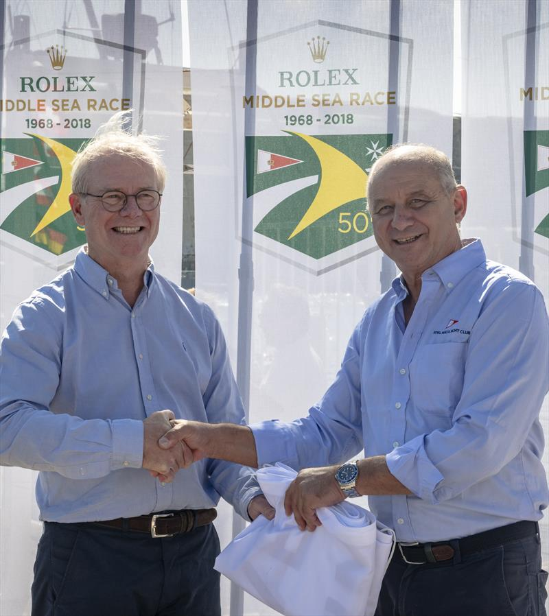 Royal Malta Yacht Club Commodore Godwin Zammit, on the right, presenting the Overall Winner's Flag to Géry Trentesaux in the Rolex Middle Sea Race 2018 - photo © Rolex / Kurt Arrigo