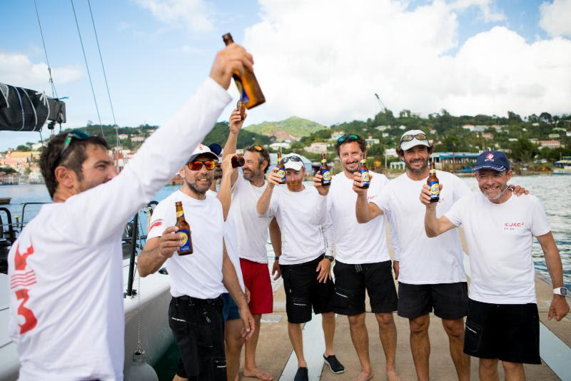Kuka3 crew enjoy a cold beer to celebrate their victory, courtesy of Camper & Nicholsons Port Louis Marina - 2018 RORC Transatlantic Race - photo © RORC / Arthur Daniel