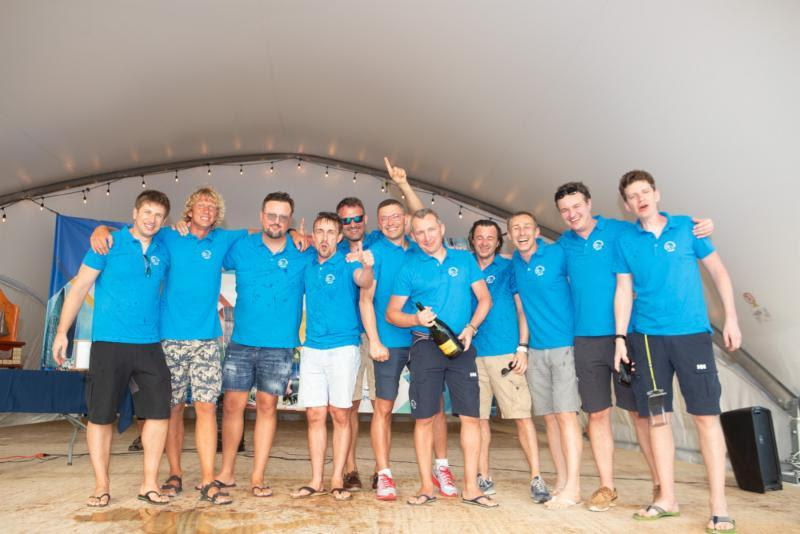 The crew of E1 Volvo 70 skippered by Rafal Sawicki celebrate at the awards ceremony at Nanny Cay in the Regatta Village - Round Tortola Race 2019 - photo © Alastair Abrehart