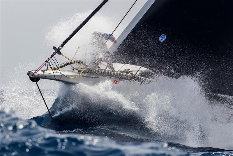 Wet ride on the bow of George David's Rambler 88. - Rolex Giraglia 2019 - photo © IMA / Studio Borlenghi