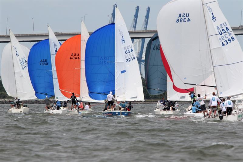 A tight grouping of J/24 sloops sails downwind toward the Ravenell Bridge during Saturday's racing - 2021 Charleston Race Week - Day 2 photo copyright Willy Keyworth taken at Charleston Yacht Club and featuring the J/24 class