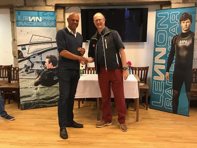 First Full rig, Mike Matan (RYA) receives his gold medal from Bowring at the Lennon Irish Laser Masters - photo © Heather King