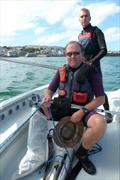 Simon Ashmore controls the jib with Graeme Sennen at the helm of St Ives Sailing Club's dinghy Redemption © Paul Maskell