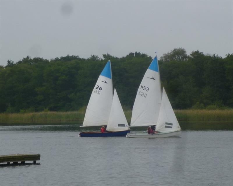 The Ayres and Sherwens in close racing during race 2 of the Leader open at Rollesby Broad photo copyright John Ayres taken at Rollesby Broad Sailing Club and featuring the Leader class