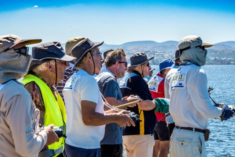 Concentration amongst the skippers at the windward mark - photo © Robert Gavin