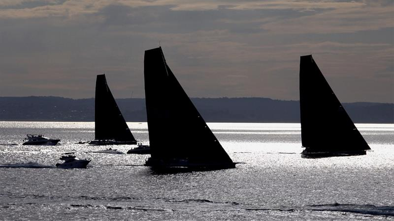 Supermaxis in silhouette after the 2018 Noakes Sydney Gold Coast Yacht Race start photo copyright Dale Lorimer taken at Cruising Yacht Club of Australia and featuring the Maxi class