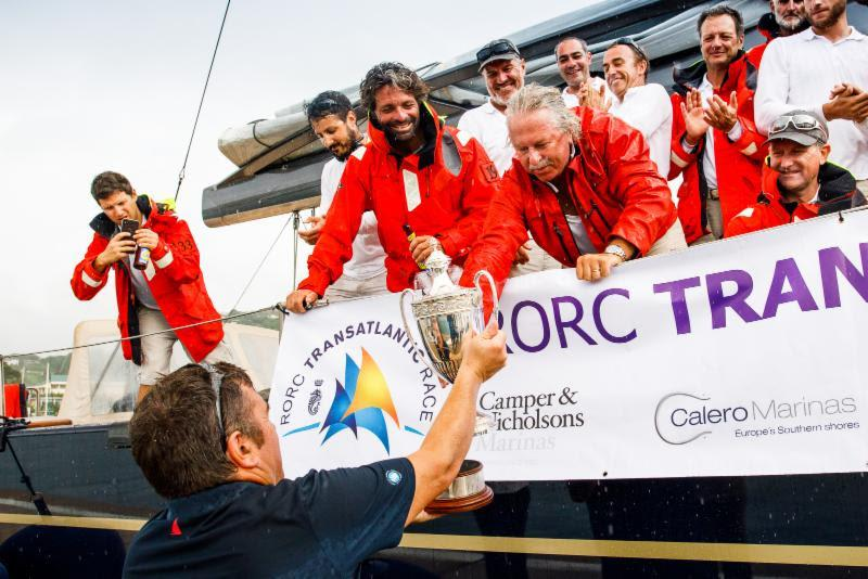 RORC Race Officer Steve Cole presents the IMA Trophy for Monohull Line Honours in the RORC Transatlantic Race photo copyright RORC / Arthur Daniel taken at Royal Ocean Racing Club and featuring the Maxi class