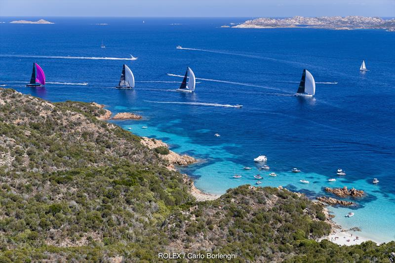 Fine, warm breeze, the craggy sandstone rock formations and azure blue waters are the reason crews return repeatedly to race off the Costa Smeralda at the Maxi Yacht Rolex Cup - photo © Rolex / Studio Borlenghi