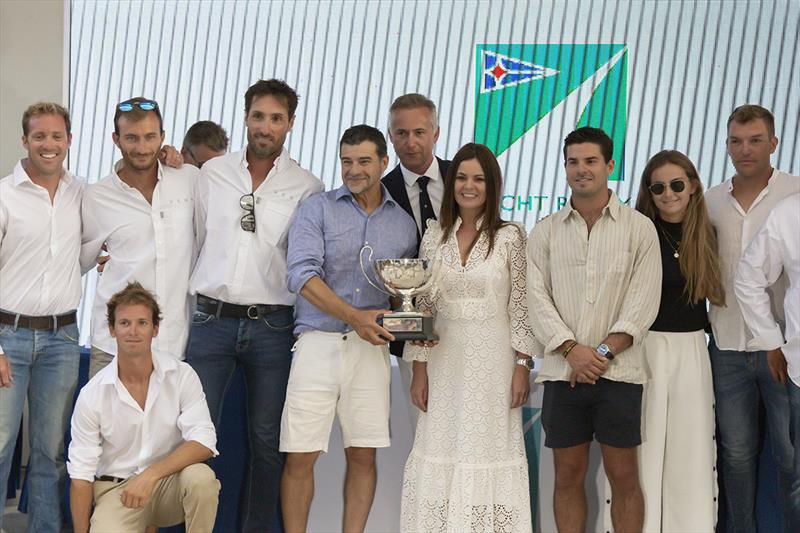 Miguel Galuccio, wife Veronica and the crew of Vera with the Mediterranean Maxi Offshore Trophy. - photo © Studio Borlenghi / International Maxi Association