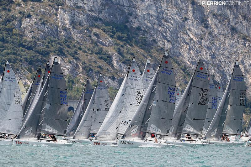 On the first day of racing the fleet was very aggressive on the starting line and with the shifty conditions was not easy to set the three boats staring line. photo copyright Pierrick Contin taken at Fraglia Vela Riva and featuring the Melges 24 class