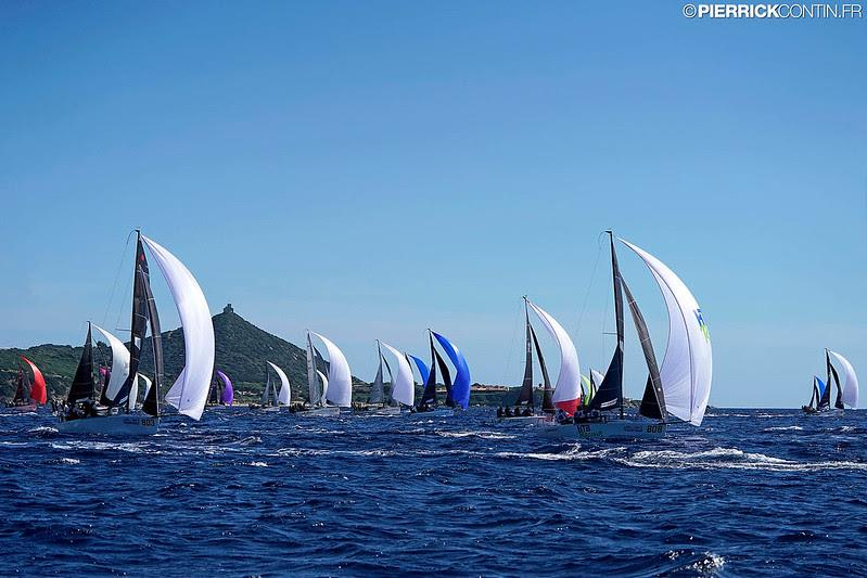 Melges 24 fleet on Day One of the Melges 24 Worlds 2019 in Villasimius. photo copyright Pierrick Contin / IM24CA taken at Lega Navale Italiana and featuring the Melges 24 class