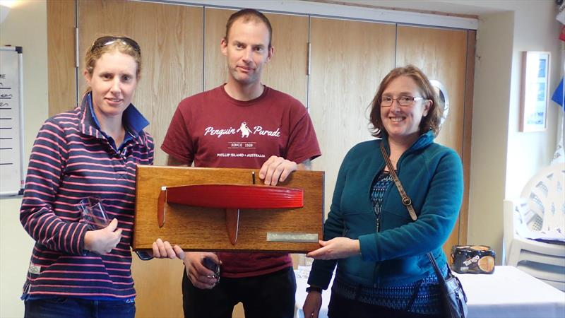 Sam and Megan Pascoe are presented with the winners trophy by Helen Green after the Merlin Rocket Open at Chichester photo copyright Nigel Cowan taken at Chichester Yacht Club and featuring the Merlin Rocket class