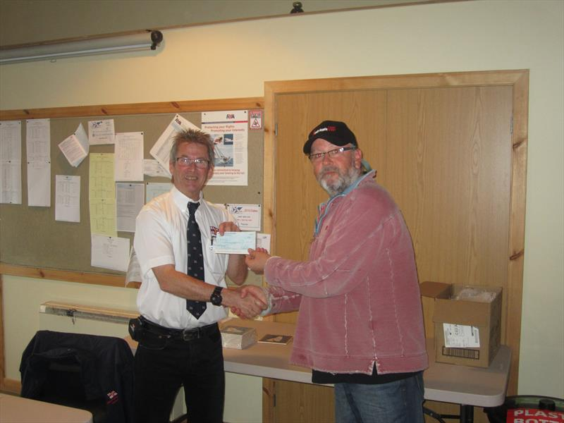Jim Holland, Solway YC Commodore (right), presenting Gareth Jones, RNLI Kippford Operations Manager, with a cheque for £550 raised by competitors in the Solway YC Kippford RNLI Regatta - photo © Ian Purkis