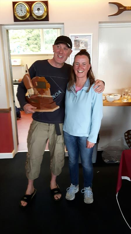 Damian Bracken presented with new GP14 Ulster Championship trophy by Laura Thompson photo copyright Laura Thompson taken at East Down Yacht Club