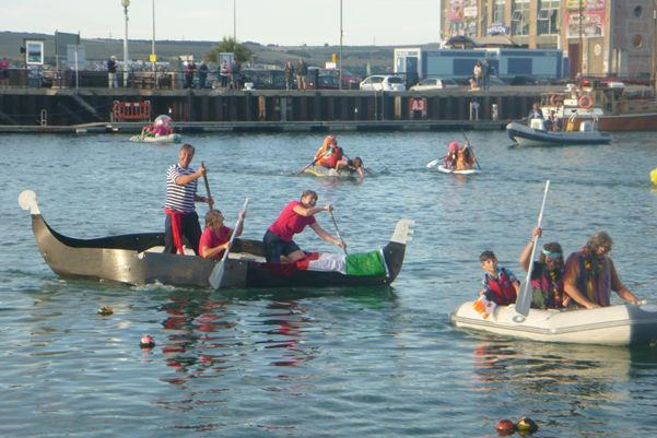 Fancy dress tender race across Weymouth Harbour during the 2018 Whyboats Weymouth Yacht Regatta - photo © Kathy Claydon