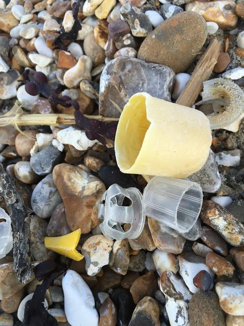 Bottle tops amongst the stones on Witterings Beach photo copyright Gael Pawson taken at